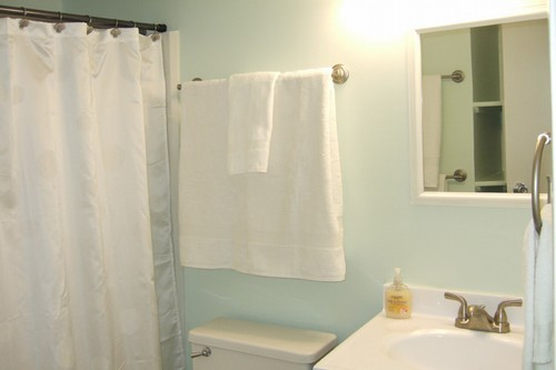 bathtub shower combo. Bathroom has a tub/shower